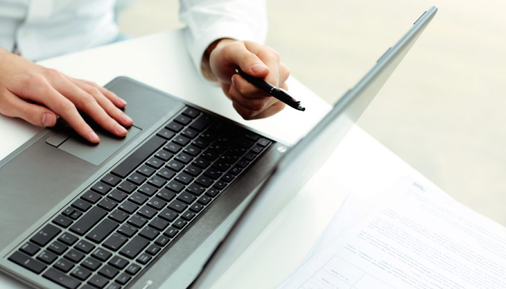 Businessman pointing at laptop and showing something